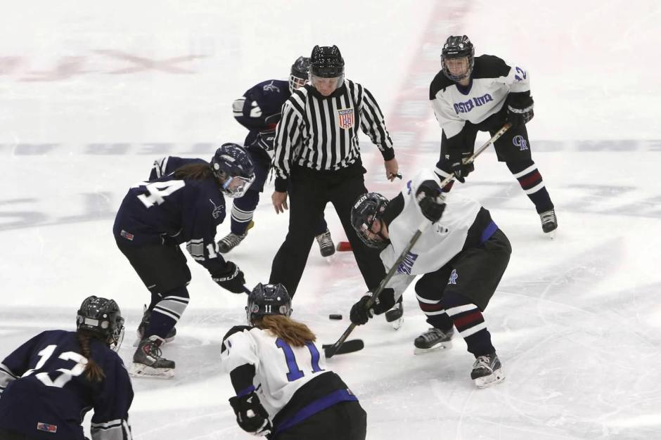 girls hockey face off